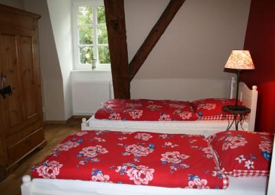 Das-rote-Schlafzimmer-der-Remise